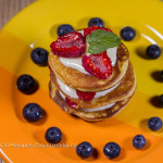 Small pancakes with curd puree and fruit